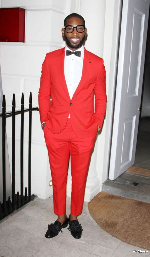 8890-tinie-tempah-posed-in-a-red-suit-at-the-500x0-3